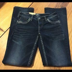 Silver Aiko Mid Rise Bootcut Denim Jeans.